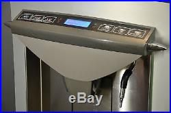 Thermoplan Tiger CTM commercial automatic bean to cup coffee machine. Espresso